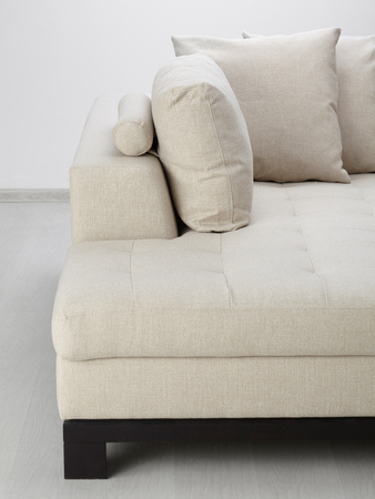 White sofa isolated against the wall Stock Photo