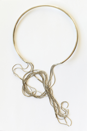 Jewelry silver necklace on white background. Hard mount and free-hanging chains