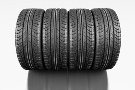 Four car tires on white background.