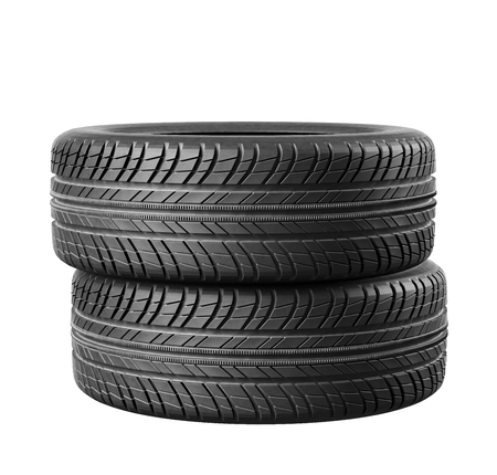 Two new car tires close up on white background.