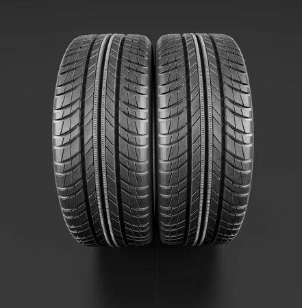 shiny car: Two new car tires close up on black background. Include clipping path. 3d illustration