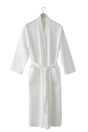 White bathrobe isolated on white background. Include clipping path Фото со стока