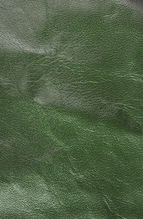 leatherette: Green leather texture.  Vertical, close up Stock Photo