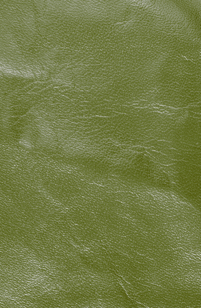 leatherette: Yellow leather texture. Vertical, close up