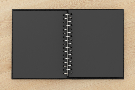 Blank black facing pages of notebook on a spring with leather cover. Mock up isolated on wooden background include clipping path on the edge of the notebook. 3d render Stock Photo