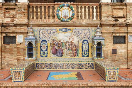 moorish clothing: Symbol of Coruna. Coat of arms, map and decorative panels on Plaza de Espana (Spain Square) in Seville, Andalusia, Spain. Stock Photo