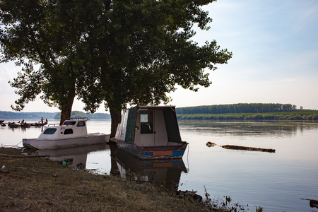 dinghies: Fishing boats anchored on Danube river on evening. Serbia.