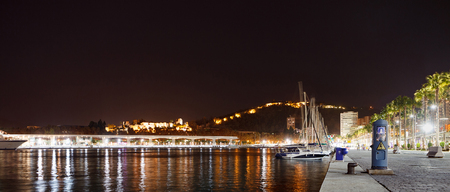 Landscape night view of Malaga from sea with night lights. Andalusia, Spain Stock Photo