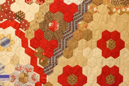 Vintage fabric texture of colorful pattern of hexagonal patches. Folk crafts. Andalusia, Spain, the beginning of the 20th century Stock Photo