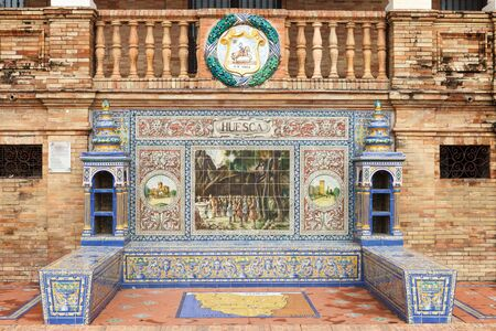 moorish clothing: Symbol of Huesca. Coat of arms, map and decorative panels on Plaza de Espana (Spain Square) in Seville, Andalusia, Spain.