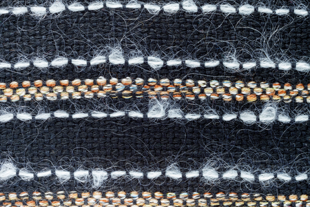 Red hand weaving matting tweed fabric texture. Closeup horizontal fragment