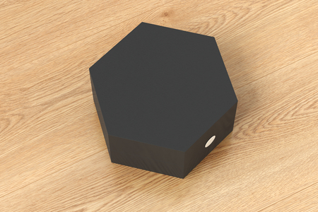 Black hexagon gift box isolated on wooden background. 3d render