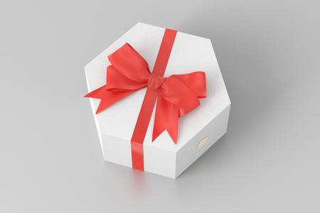 Witte hexagon giftdoos met rode boog die op witte achtergrond met het knippen van weg wordt geïsoleerd. 3d render