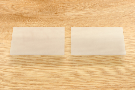 Blank Transparent Business Cards Above Wooden Background 3d Render Stock Photo