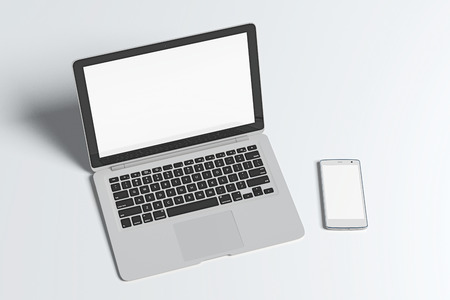 Blank screen laptop and smartphone isolated on white background with clipping path. 3d illustration