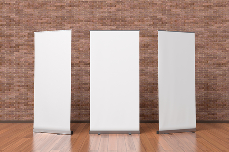 Three Blank White Roll Up Banner Stands Isolated In Interior Stock