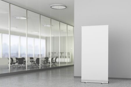 Blank roll up banner stand in bright office interior with clipping path around ad banner. 3d illustration Reklamní fotografie