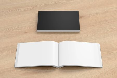 paperback: Blank black landscape soft cover book with glossy paper on wooden background. Open and closed, isolated with clipping path around each book. 3d illustration Stock Photo