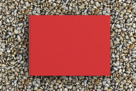 Blank landscape red book cover mockup on gravel isolated with clipping path around cover. 3d illustration Stock Photo