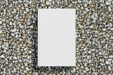 beach closed: Blank vertical white book cover mockup on gravel isolated with clipping path around cover. 3d illustration