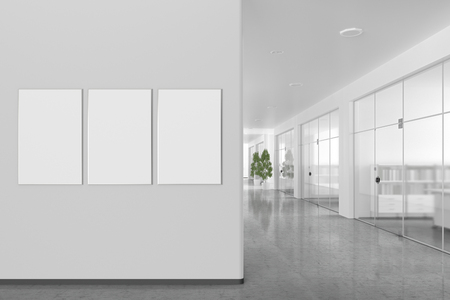 Three blank posters on the wall in bright office interior with clipping path around banner. 3d illustration Stock Photo