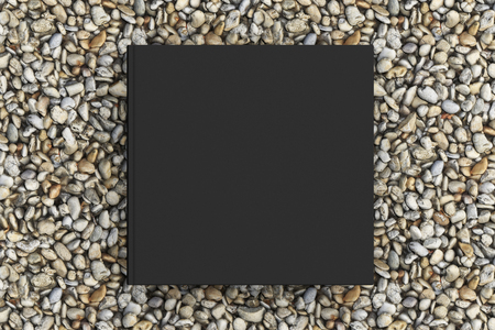 Blank square black book cover mockup on gravel isolated with clipping path around cover. 3d illustration Stock Photo