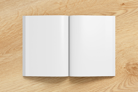 Blank pages of open portrait soft cover book with glossy paper. Isolated  on wooden background with clipping path around book. 3d illustration.
