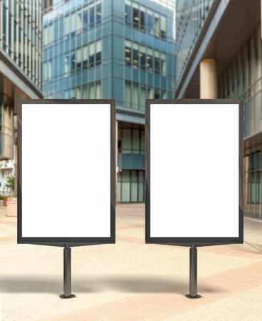 lightbox: Two blank vertical street billboard poster on city background. 3d illustration.