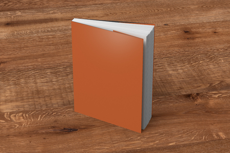 Blank orange vertical dust jacket or dust wrapper standing book. Isolated with clipping path around book. 3d illustration. Reklamní fotografie