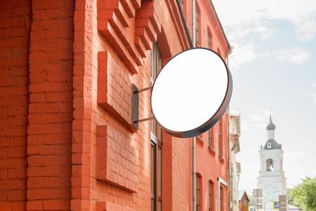 3d om: Blank shop sign om brick wall. Round signage mockup. 3d illustration. Stock Photo