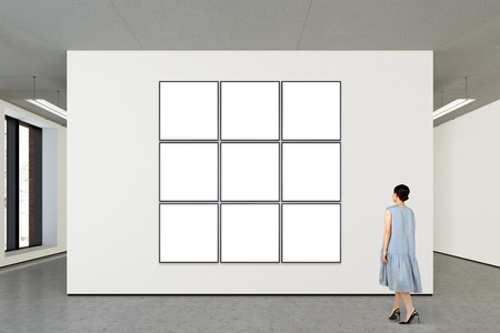 Woman looking at nine tiled blank posters in modern gallery. Posters isolated with clipping path. 3d illustration