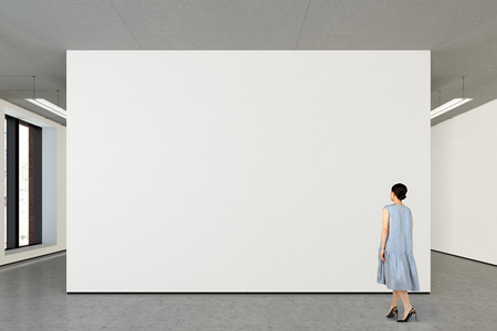 Woman looking at blank wall in modern gallery. Poster isolated with clipping path. 3d illustration