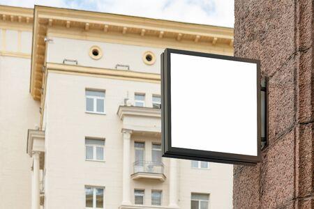 Blank square signboard on the granite wall. 3d illustration 版權商用圖片