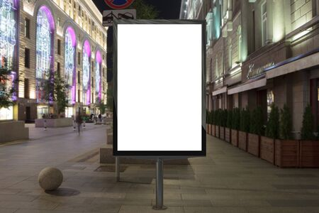 city background: Blank street billboard at night city. Isolated with clipping path around advertising display. 3d illustration.