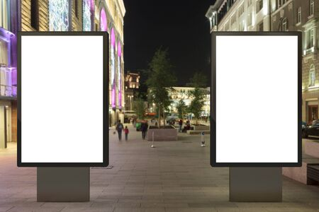 city background: Two blank street billboards at night. Isolated with clipping path around advertising display. 3d illustration.