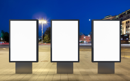 city background: Three blank street billboards at night city. Isolated with clipping path around advertising display. 3d illustration.
