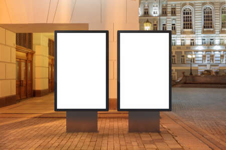 city background: Two blank street billboards at night. Stock Photo