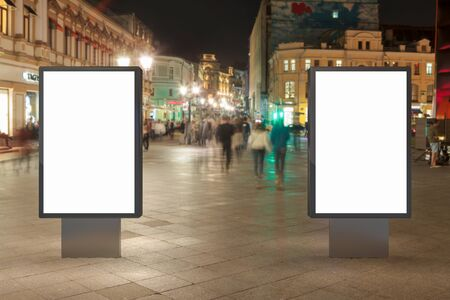 two: Two blank street billboards at night. Isolated with clipping path around advertising display. 3d illustration.