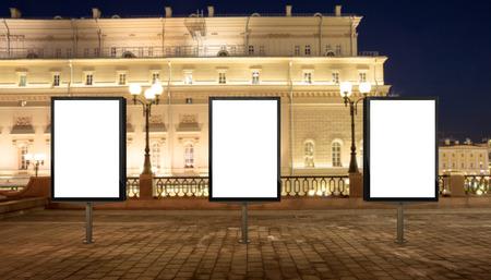 city background: Three blank street billboards at night city.