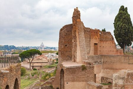 The Domus Augustana or Roman Palace of Domitian with St. Peters Basilica on background. View of Palatine hill, Rome, Italy. Stock Photo