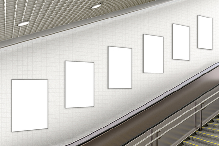 Line of blank vertical advertising posters on wall of underground escalator. 3d illustration
