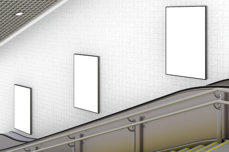 Three blank vertical advertising posters on wall of underground escalator. 3d illustration Stock Photo