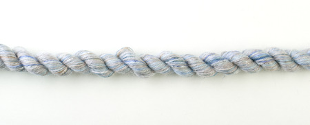 Decorative cyan  braided curtain cord. Slice on white background