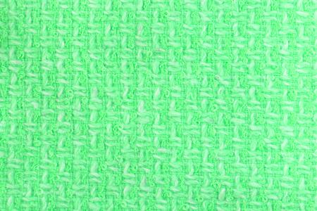Green tweed jacquard texture clouseup