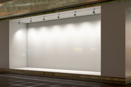 Empty store window at night.  Illuminated storefront showcase. 3d illustration