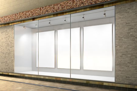 Empty store window. Three blank posters in illuminated storefront showcase. 3d illustration  Banque d'images