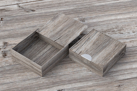 Two vintage wooden square boxes with sliding lid on old wooden background. Empty opened and closed box. Include clipping path around each box. 3d illustration Stock Photo