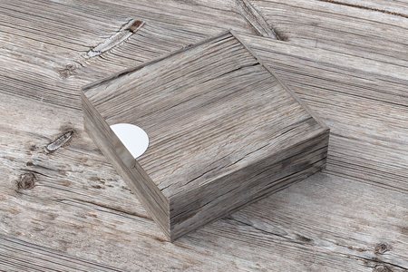 Blank vintage wooden square box with closed sliding lid on old wooden background. Include clipping path around box. 3d illustration Stock Photo