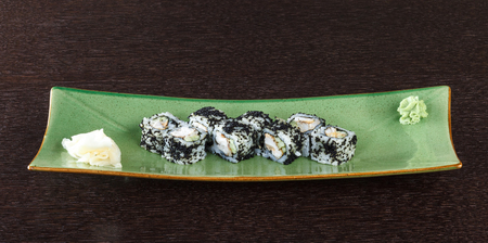 Sushi rolls with tuna and  black roe on wooden table. Side view. Stock Photo - 99218943