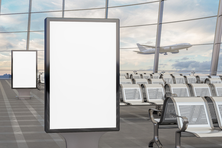 Airport departure lounge. Two blank billboard stands and airplane on background. Include clipping path around advertising posters. 3d illustration  Stock Photo